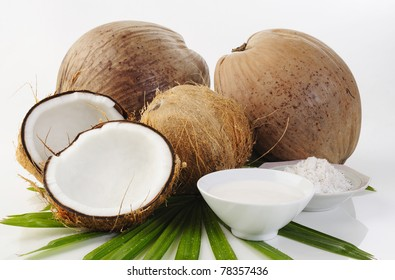 coconut, shredded coconut, and coconut cream on white