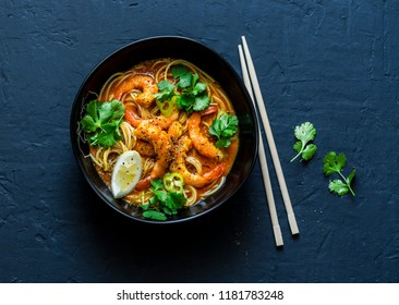 Coconut shrimp laksa soup on a dark background, top view. Copy space