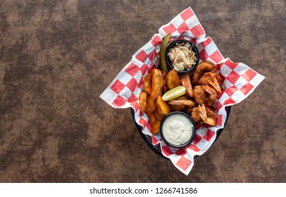 Coconut Shrimp with Thick Cut Fried Potatos and Cole Slaw