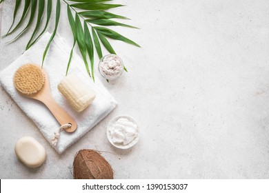 Coconut Spa composition, flat lay, copy space. Natural spa coconut cosmetics and organic treatment concept on white, copy space.