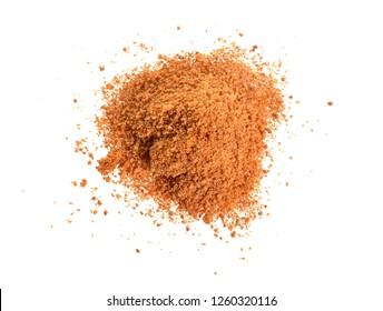 Coconut sugar, also known as coco sugar, coconut palm sugar, coco sap sugar or coconut blossom. Isolated on white background.