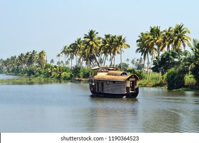 Coconut trees and houseboat-Alleppey backwaters/Alappuzha-Kerala
