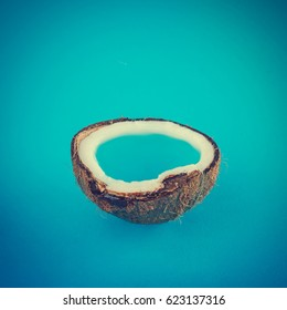 Coconut tropical island on blue background. Minimal summer concept. Flat lay.