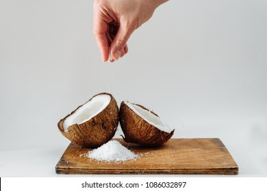 Coconut vegan milk background white vegan concept with copy space glass beverage shaving flax hand coconut shaving up