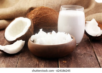 Coconut vegan milk non dairy in bottle and coconut oil on wooden table