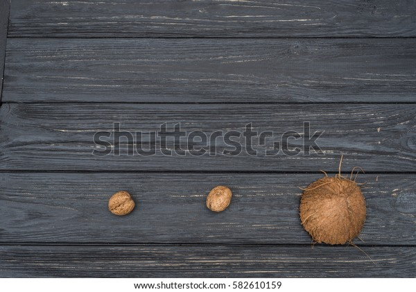 Coconut and walnuts on grey wooden table