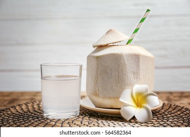 Coconut water and fresh nut on wicker mat