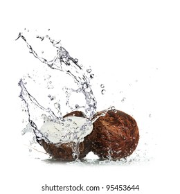 Coconut with water splash over white