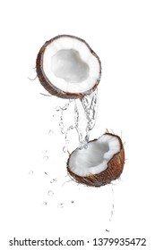 Coconut with water splashes, isolated on white