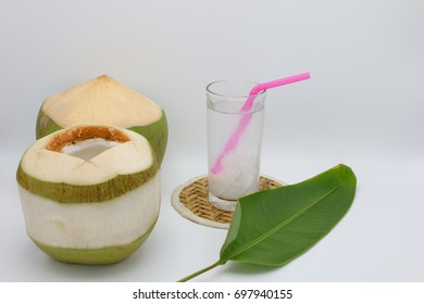 Coconut water with straw on white isolated background, juice