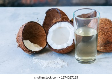 Coconut water, whole coconuts on a white background. Coconut products concept.