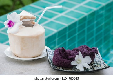 Coconut is a welcome drink with cool cloth purple color decorated with Thai orchids.Koh Samui Thailand