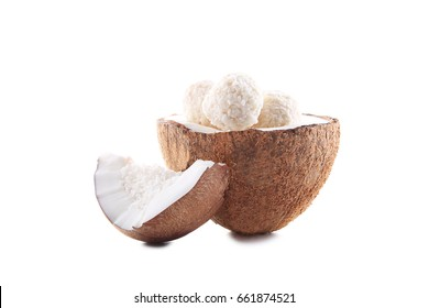 Coconuts with candies isolated on a white background