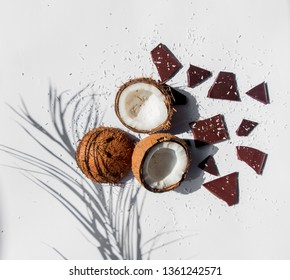 coconuts and dark chocolate on white bacgkround with shadows