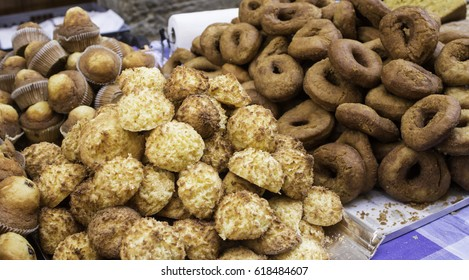 Coconuts and donuts in food market, desserts