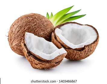 Coconuts isolated. Coconut half, coco piece and leaves isolate. Full depth of field.