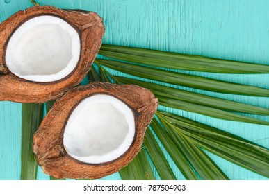 Coconuts with leaves on wood background,