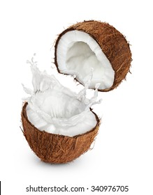 Coconuts with milk splash on white background. Close up.