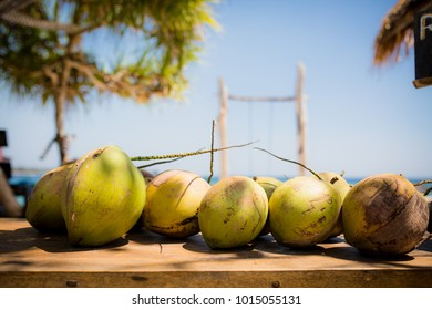 Coconuts on a table in Gili Meno