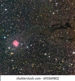 Cocoon Nebula is a star forming region in Cygnus, about 4000 light years away. The long exposure photo shows the dark lane leading to it. Made with a professional astronomy telescope and CCD camera.