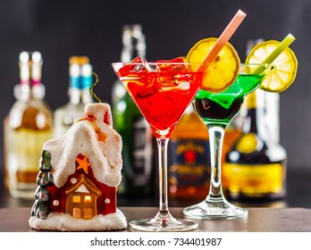 Coctail and beautiful Christmas house, candle, bottle background, xmas set, snow