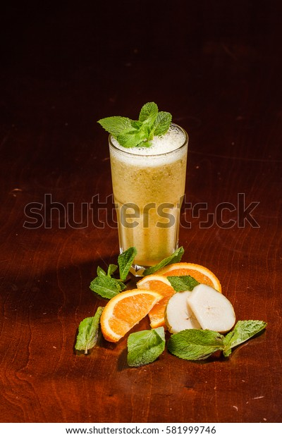 Coctail in a glass with pear and orange