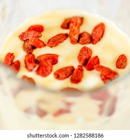 Coctail from guava, banana, yoghurt, decoration with goji berries