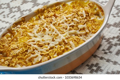 Cod Au Gratin - appetizer from New Foundland, Canada, Flaked cod is layered with white sauce, and sprinkled with Cheddar cheese before being baked in this simple casserole.