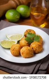 Cod dumpling. Traditional brasilian snack. Bunuelos de bacalão.
