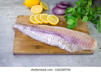 Cod fillet with lemons and onions