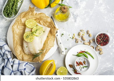 Cod fillets with vegetables before cooking in parchment paper. top view