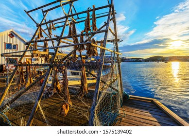 Cod fish drying rack illuminated with evening sun in the border of Barents Sea. The picture is taken in fishers village  Gjesvaer in the west of Mageroya Island. Nordkapp Municipality in Norway