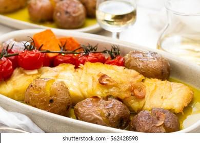 cod fish with potato and tomato cherry on dish