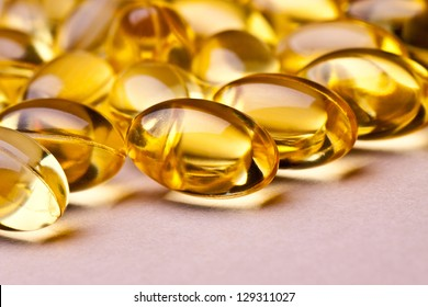 Cod liver oil omega 3 gel capsules isolated on pastel background