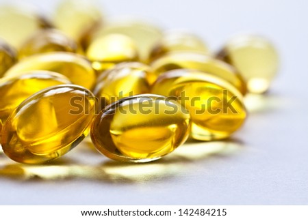 Cod liver oil omega 3 gel capsules isolated on pastel background. Vitamin capsuls