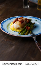 cod on plate with sparris and bacon