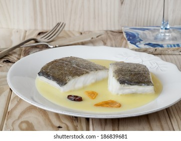 Cod with pil-pil sauce (Bacalao al pil pil), Basque cookery.