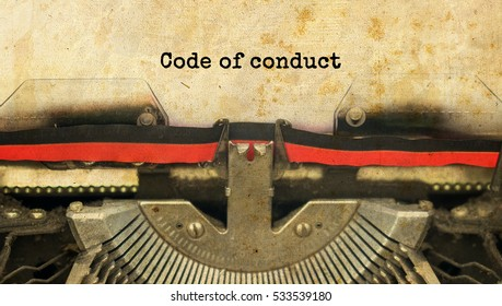 Code of conduct typed words on a vintage typewriter with vintage background