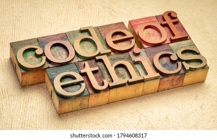 code of ethics text in vintage letterpress wood type printing blocks stained by color inks, values, ethical principles, and standards concept