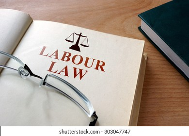 Code of labour  law on a wooden table.