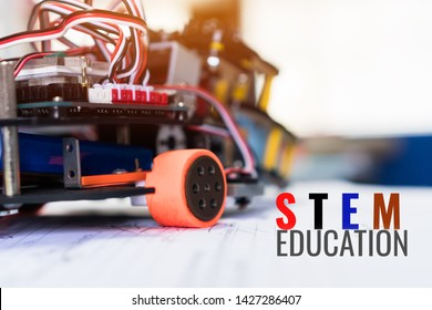 Code of learning construction car robotics on electronic board with equipment in laboratory of school.Concept of STEM education related of mathematics engineering science technology study for children