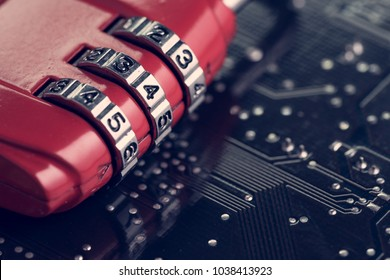 Code numbers on combination pad lock on computer circuit board with solder, digital cyber safety or security encryption concept, technology to encode online information or data protection.