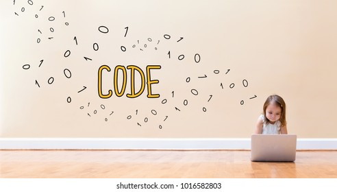 Code text with little girl using a laptop computer on floor