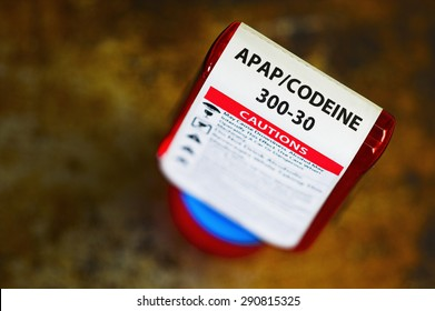 Codeine prescription bottle with warning label. Codeine is a narcotic analgesic (pain reliever).