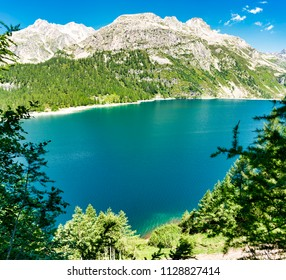 Codelago Lake in Devero Alp, scenic i talian landscape in a clear summer day with mountains and blue sky in background, Piedmont - Italy