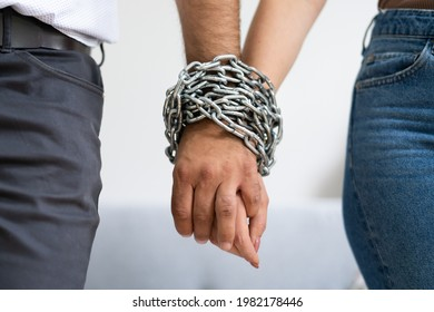Codependent Relationship Couple. Hand Tied By Chain