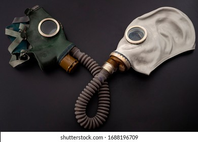 Codependent relationship, negative emotions, hazardous affair and toxic love concept with two gas masks connected on the same hose to represent codependency isolated on dark background