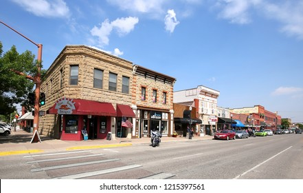 "CODY, WYOMING - AUGUST:  Downtown street in Cody, founded in 1896 by Colonel William F. ""Buffalo Bill"" Cody, designed with wide streets so his wagons could turn around as seen on August 26, 2018."