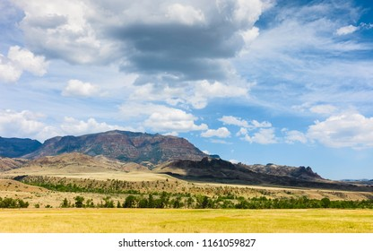 Cody, Wyoming, USA. View across the prairie towards the Rocky mountains on a bright summer day under blue sky, Cody, Wyoming, USA.
