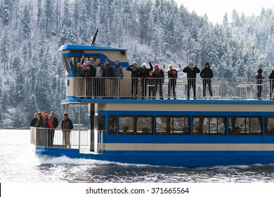 Coeur d' Alene, Idaho - December 16: Winter eagle watch tour boat with young people enjoying a beautiful winter day on lake CDA, December 16 2015 in Coeur d' Alene, Idaho